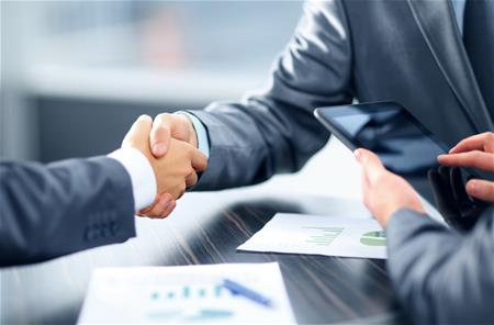 stock-photo-business-handshake-130099715